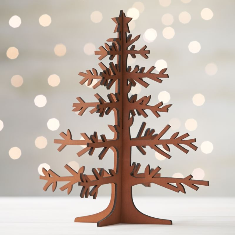 Graphic wood trees are laser-cut in realistic detail, easily assembled into dimensional, freestanding conversation pieces. Large tree with star top and mid-tone finish can be paired with our laser-cut animals and village for a full decorative statement.<br /><br /><NEWTAG/><ul><li>Laser-cut plywood</li><li>Mid-tone finish</li><li>2 pieces</li><li>Stores flat</li><li>For decorative use only; not a toy</li><li>Made in China</li></ul>