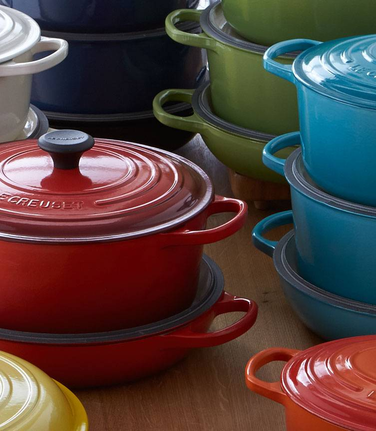 LeCreuset cookware in Flame, Ink, Soleil, Cherry, Palm, Cream and Caribbean colors.