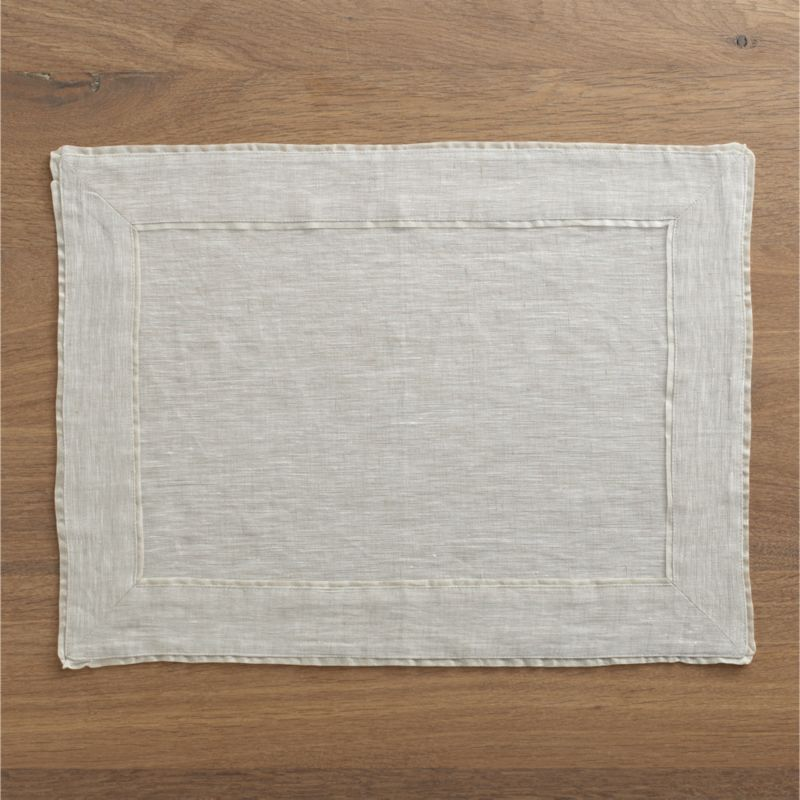 Natural linen placemat with a delicate silk tissue flange coordinates with any and every table setting.<br /><br /><NEWTAG/><ul><li>100% linen</li><li>Silk tissue flange</li><li>Machine wash, reshape and dry flat; warm iron as needed</li></ul>