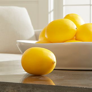 Fill a bowl with our always-fresh, super-realistic faux lemons for a splash of refreshing color any time of year.