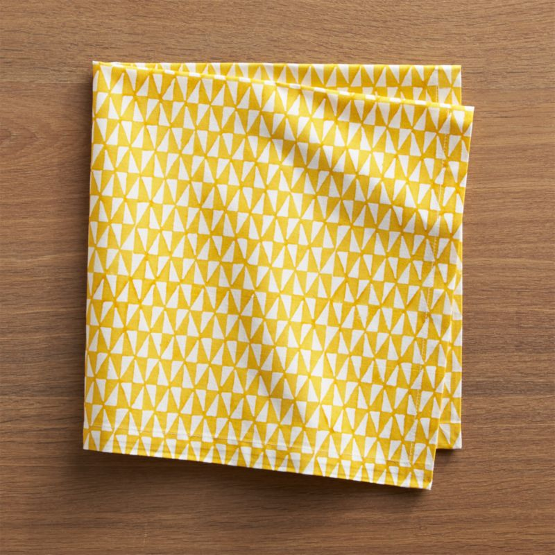 Handcarved wood blocks pattern yellow and white triangles for a cheerful, contemporary napkin. Due to its handcrafted nature, each napkin's patterning will vary slightly.<br /><br /><NEWTAG/><ul><li>Handcrafted</li><li>100% cotton</li><li>Machine wash napkin separately in cold water, dry flat; warm iron as needed</li><li>Do not dry clean or bleach</li></ul>