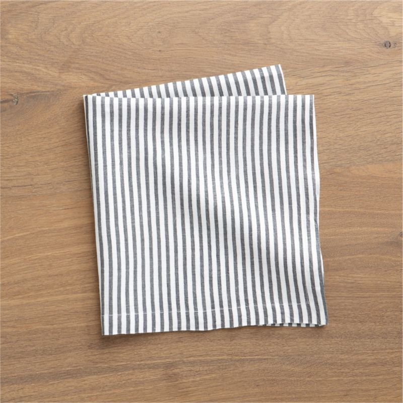 Hand-printed organic stripes line white linen napkin in soft grey.<br /><br /><NEWTAG/><ul><li>Handcrafted</li><li>100% linen</li><li>Machine wash, tumble dry; warm iron as needed</li><li>Oversized to allow for shrinkage</li><li>Made in India</li></ul>