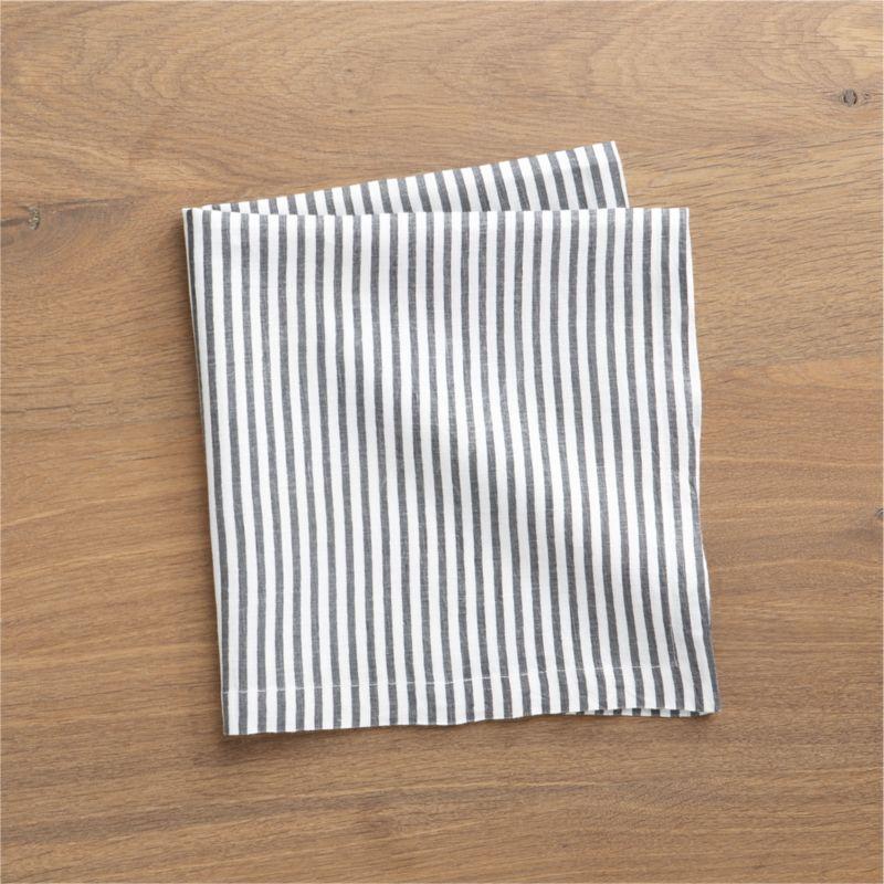 Hand-printed organic stripes line white linen napkin in soft grey.<br /><br /><NEWTAG/><ul><li>Handcrafted</li><li>100% linen</li><li>Machine wash, tumble dry; warm iron as needed</li><li>Oversized to allow for shrinkage</li><li>Made in India</li></ul>