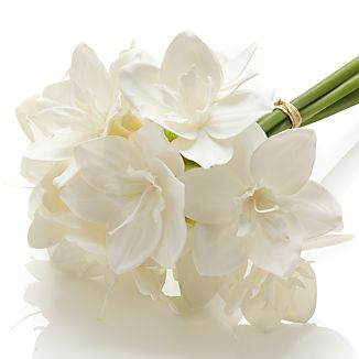 Pure white and delicate in form, lilies are a springtime favorite. Our bouquet boasts lifelike blooms that will grace the Easter or Mother's Day table.
