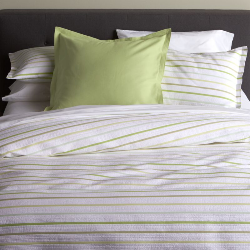 Jacquard dobby weave lends seersucker freshness to cool white cotton bed linens textured with slim bands of tonal greens. Duvet cover has interior fabric ties. Shams have overlapping back closures. Duvet insert also available.<br /><br /><NEWTAG/><ul><li>100% cotton</li><li>Dobby jacquard weave</li><li>Interior fabric ties</li><li>Machine wash cold, tumble dry low; warm iron as needed</li><li>Made in Portugal</li></ul>