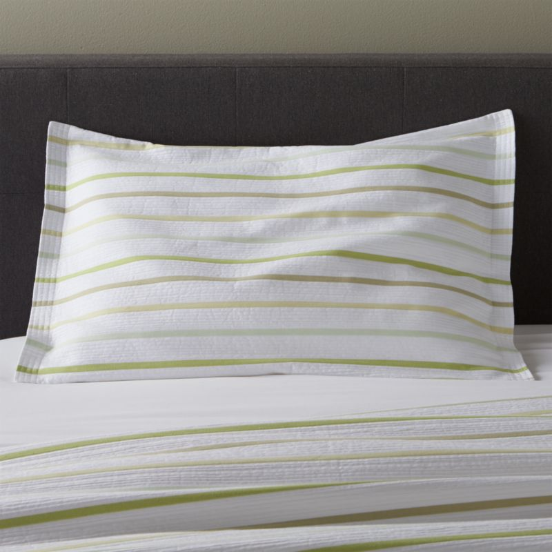 Jacquard dobby weave lends seersucker freshness to cool white cotton bed linens textured with slim bands of tonal greens. Shams have overlapping back closures. Solid lime Lima Euro Sham coordinates. Bed pillows also available.<br /><br /><NEWTAG/><ul><li>100% cotton</li><li>Dobby jacquard weave</li><li>Overlapping back closure</li><li>Machine wash cold, tumble dry low; warm iron as needed</li><li>Made in Portugal</li></ul>