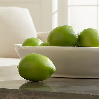 Fill a bowl with our always-fresh, super-realistic faux limes for a splash of refreshing color any time of year.