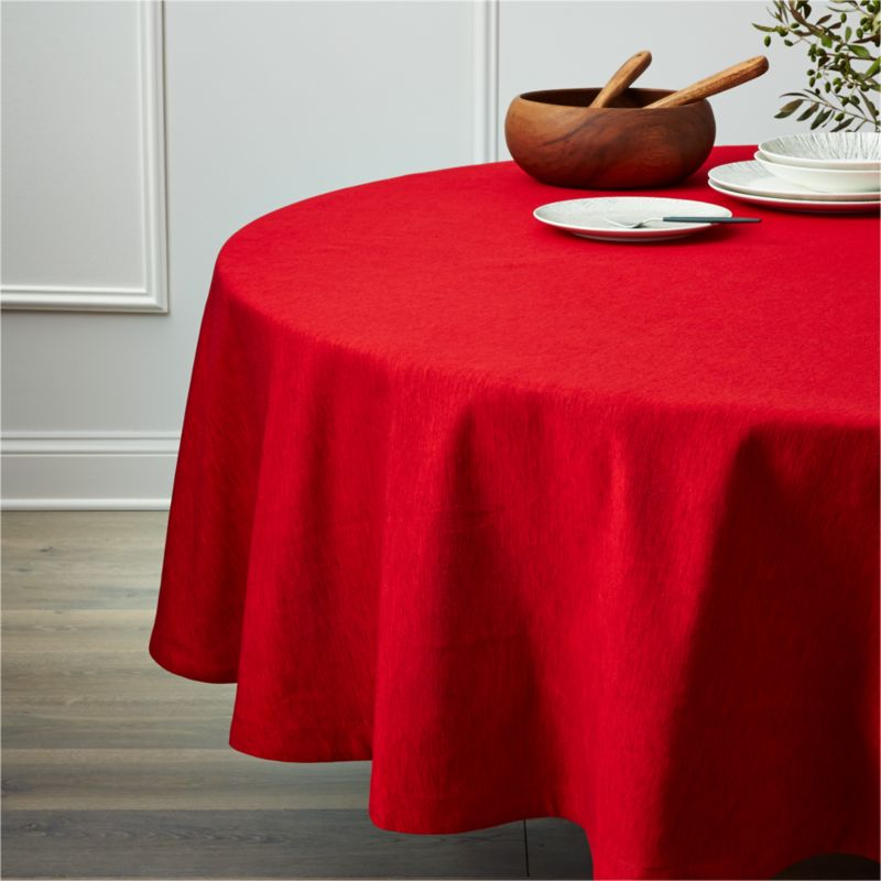 A classic staple for any kind of entertaining, this ruby red round tablecloth is woven of hand-dyed, cotton and rayon yarns, resulting in rich tone-on-tone color and variable texture.<br /><br /><NEWTAG/><ul><li>63% cotton and 37% rayon</li><li>Machine wash cold, tumble dry low until damp; warm iron as needed</li><li>Do not bleach</li><li>Oversized to allow for shrinkage</li><li>Made in India</li></ul><br />