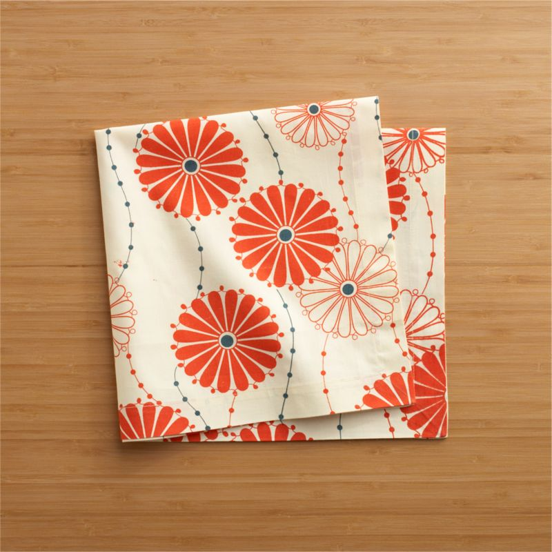 "Traditional Japanese floral pattern blooms bright and contemporary in blue and orange, trailing solid and outlined mums on delicate stems. Cotton napkin is tailor finished with 1"" hem and mitered corners.<br /><br /><NEWTAG/><ul><li>100% cotton</li><li>Machine wash, tumble dry; warm iron as needed</li><li>Made in India</li></ul>"