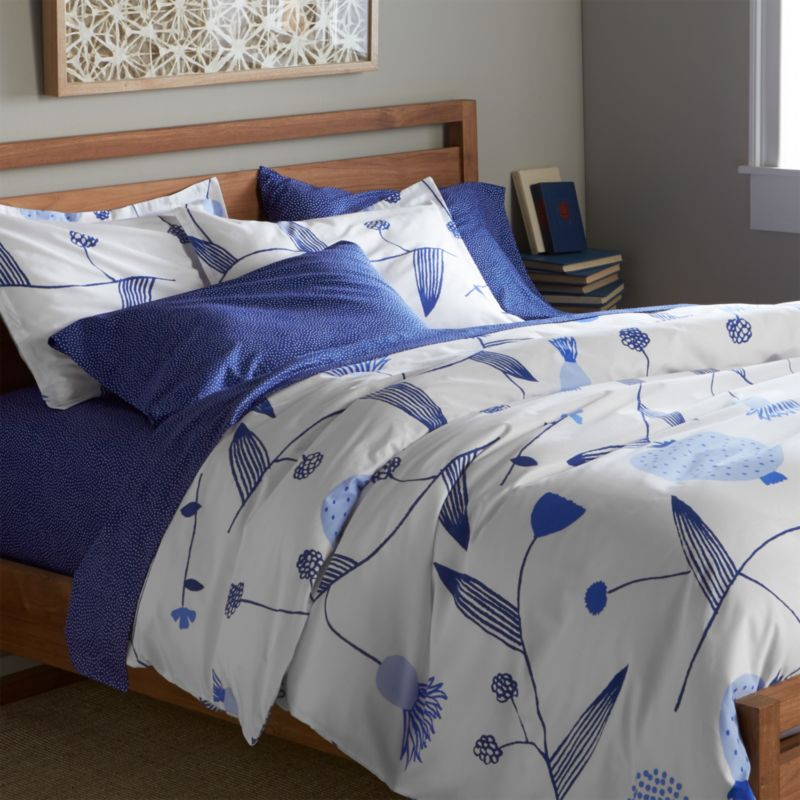 Fujiwo Ishimoto's interpretation of the stark beauty of Finland's Lapland scatters line drawings of blue vines, leaves and flowers on crisp white cotton percale. Duvet has hidden button closure and interior fabric ties to keep insert in place. Duvet insert also available.<br /><br /><NEWTAG/><ul><li>Designed by Fujiwo Ishimoto</li><li>100% cotton percale</li><li>300-thread-count</li><li>Hidden button closure and interior fabric ties</li><li>Machine wash cold, tumble dry low; warm iron as needed</li><li>Made in Pakistan</li></ul>