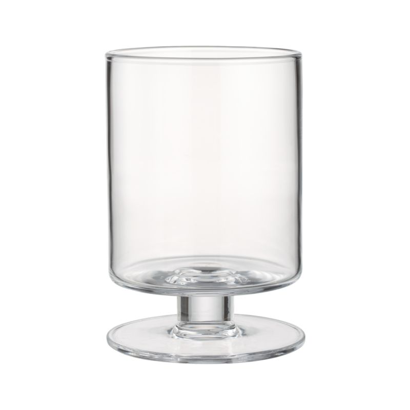 "A Crate and Barrel classic, handcrafted glass hurricanes, look as beautiful reflecting candlelight as they do filled with twinkling garlands or terrarium plantings. London Wide Short Glass Hurrican Candle Holder is handmade in crystal-clear glass by artisans at a European glass collective dating back to 1923.<br /><br />See our ideas and advice about <a href=""/ideas-and-advice/wedding-table-setting-ideas"">setting beautiful wedding tables</a>.<br /><br /><NEWTAG/><ul><li>Handcrafted</li><li>Glass</li><li>Accommodates up to a 4""-diameter pillar candle, sold separately</li><li>Clean with damp cloth</li><li>Made in Poland</li></ul>"