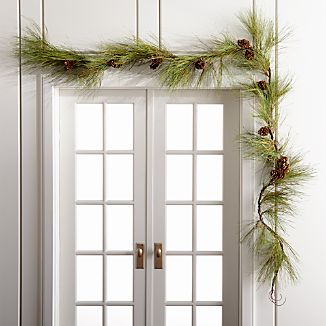 Handcrafated garland of faux long-needled pine branches and all-natural pinecones creates striking 6' swags.