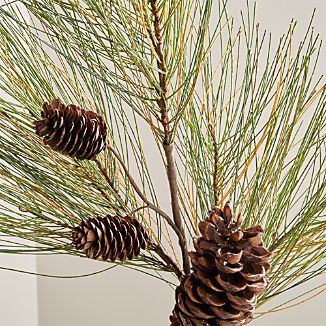 Handmade spray of faux pine needles and real pinecones adds the lush look of real pine to the mantel or centerpiece.