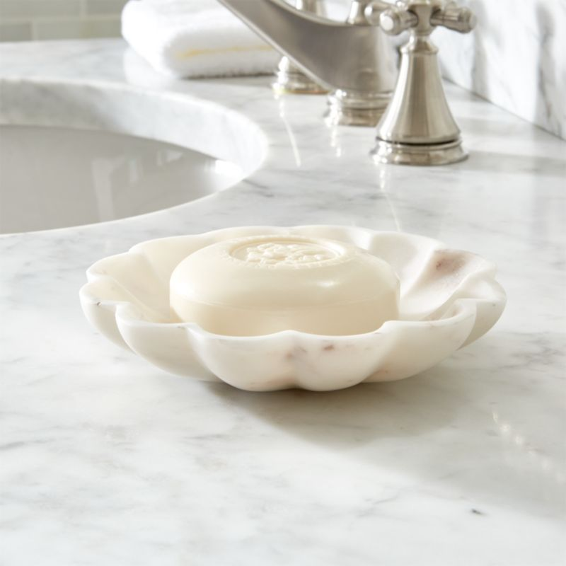 Creamy natural marble blooms natural color in the bath. Low, scalloped bowl holds rounds or bars of soap and keeps jewelry safe while bathing. Stone color will vary.<br /><br /><NEWTAG/><ul><li>100% marble</li><li>Clean with damp cloth</li><li>Made in India</li></ul>