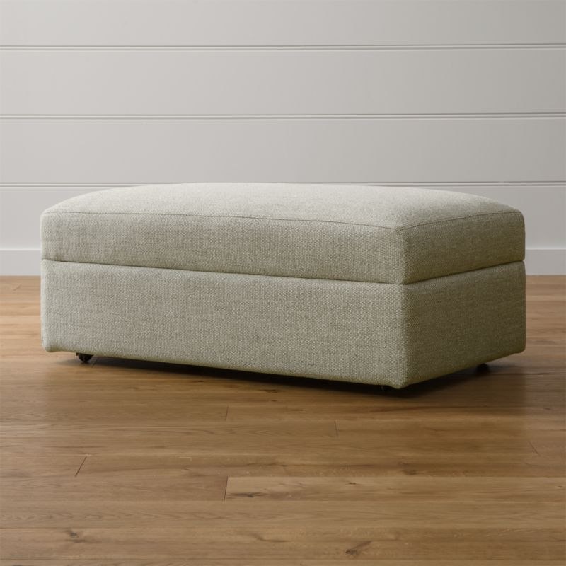 Lounge ii storage ottoman with casters taft cement for Crate and barrel pouf