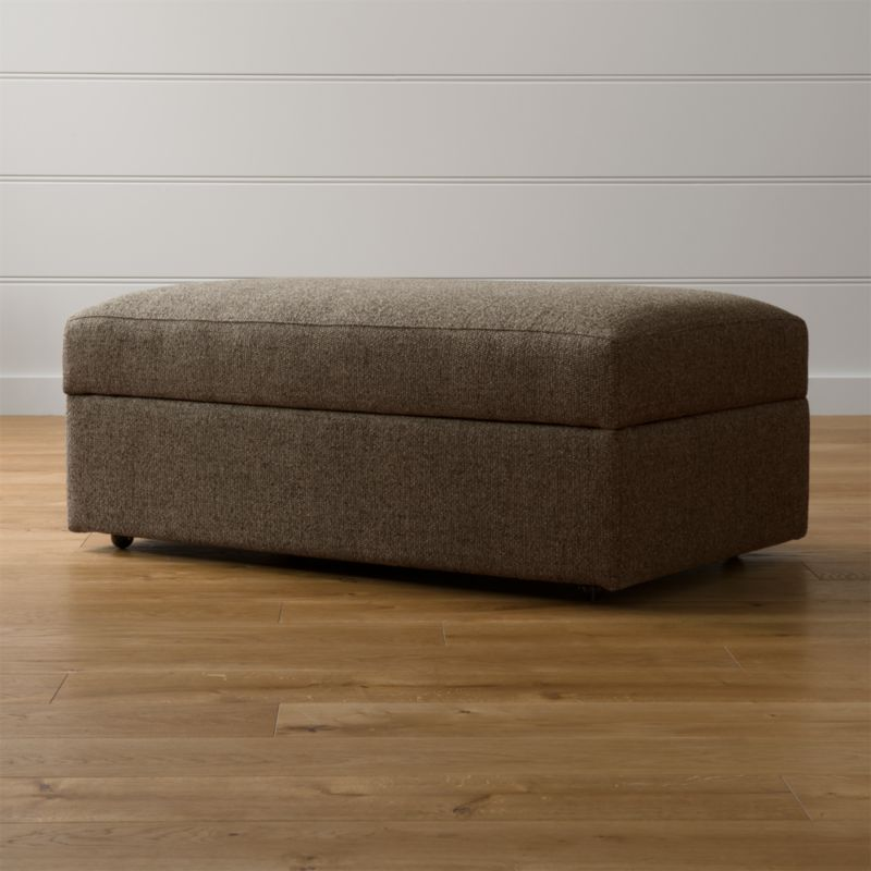 Lounge ii storage ottoman with casters taft truffle for Crate and barrel pouf