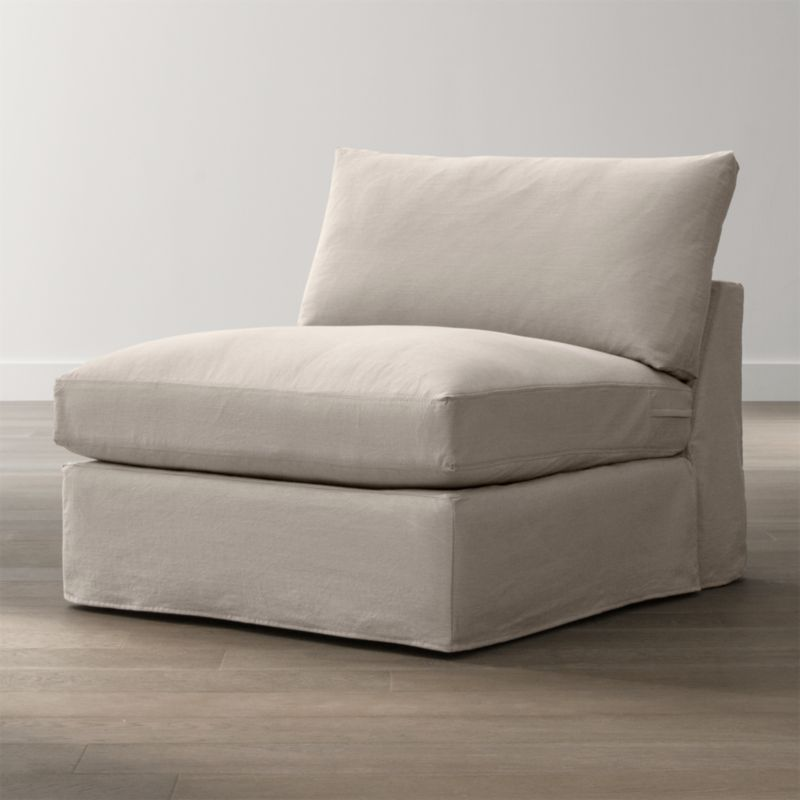 """Tailored to fit our Lounge Slipcovered 93"""" Sofa, smart denim slipcover is tailored with a kickpleat skirt and jumbo double topstitch outlining its high slim arms and plump, deep cushions.<br /><br />Additional <a href=""""http://crateandbarrel.custhelp.com/cgi-bin/crateandbarrel.cfg/php/enduser/crate_answer.php?popup=-1&p_faqid=125&p_sid=DMUxFvPi"""">slipcovers</a> available below and through stores featuring our Furniture Collection.<br /><br />After you place your order, we will send a fabric swatch via next day air for your final approval. We will contact you to verify both your receipt and approval of the fabric swatch before finalizing your order.<br /><br /><NEWTAG/><ul><li>100% cotton</li><li>Machine washable</li><li>Jumbo contrast saddle stitch detail</li><li>Made in North Carolina, USA of domestic and imported materials</li></ul><br />"""