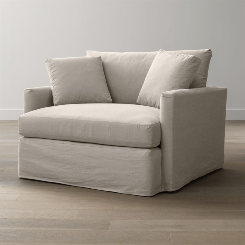 "Tailored to fit our Lounge Chair and a Half, smart denim slipcover is tailored with a kickpleat skirt and jumbo double topstitch outlining its high slim arm and plump, deep cushions.<br /><br />Additional <a href=""http://crateandbarrel.custhelp.com/cgi-bin/crateandbarrel.cfg/php/enduser/crate_answer.php?popup=-1&p_faqid=125&p_sid=DMUxFvPi"">slipcovers</a> available below and through stores featuring our Furniture Collection.<br /><br />After you place your order, we will send a fabric swatch via next day air for your final approval. We will contact you to verify both your receipt and approval of the fabric swatch before finalizing your order.<br /><br /><NEWTAG/><ul><li>100% cotton</li><li>Machine washable</li><li>Jumbo contrast saddle stitch detail</li><li>Made in North Carolina, USA of domestic and imported materials</li></ul><br />"