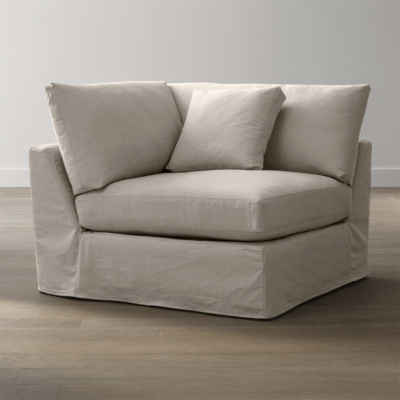 "Tailored to fit our Lounge Corner Chair, smart denim slipcover is tailored with a kickpleat skirt and jumbo double topstitch outlining its high slim arm and plump, deep cushions.<br /><br />Additional <a href=""http://crateandbarrel.custhelp.com/cgi-bin/crateandbarrel.cfg/php/enduser/crate_answer.php?popup=-1&p_faqid=125&p_sid=DMUxFvPi"">slipcovers</a> available below and through stores featuring our Furniture Collection.<br /><br />After you place your order, we will send a fabric swatch via next day air for your final approval. We will contact you to verify both your receipt and approval of the fabric swatch before finalizing your order.<br /><br /><NEWTAG/><ul><li>100% cotton</li><li>Machine washable</li><li>Jumbo contrast saddle stitch detail</li><li>Made in North Carolina, USA of domestic and imported materials</li></ul><br />"