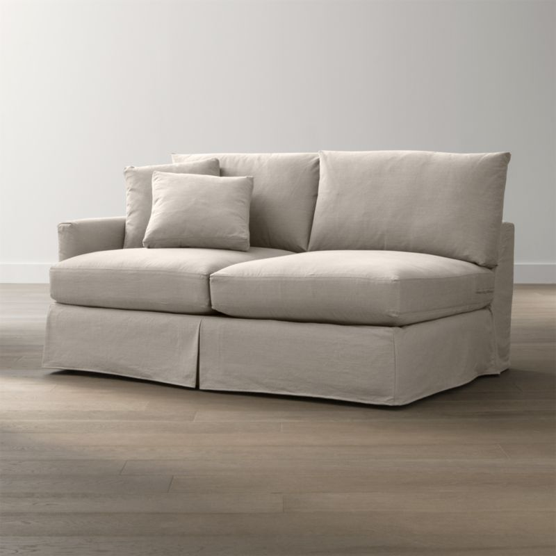 "Tailored to fit our Lounge Slipcovered Left Arm Apartment Sofa, smart denim slipcover is tailored with a kickpleat skirt and jumbo double topstitch outlining its high slim arm and plump, deep cushions.<br /><br />Additional <a href=""http://crateandbarrel.custhelp.com/cgi-bin/crateandbarrel.cfg/php/enduser/crate_answer.php?popup=-1&p_faqid=125&p_sid=DMUxFvPi"">slipcovers</a> available below and through stores featuring our Furniture Collection.<br /><br />After you place your order, we will send a fabric swatch via next day air for your final approval. We will contact you to verify both your receipt and approval of the fabric swatch before finalizing your order.<br /><br /><NEWTAG/><ul><li>100% cotton</li><li>Machine washable</li><li>Jumbo contrast saddle stitch detail</li><li>Made in North Carolina, USA of domestic and imported materials</li></ul><br />"