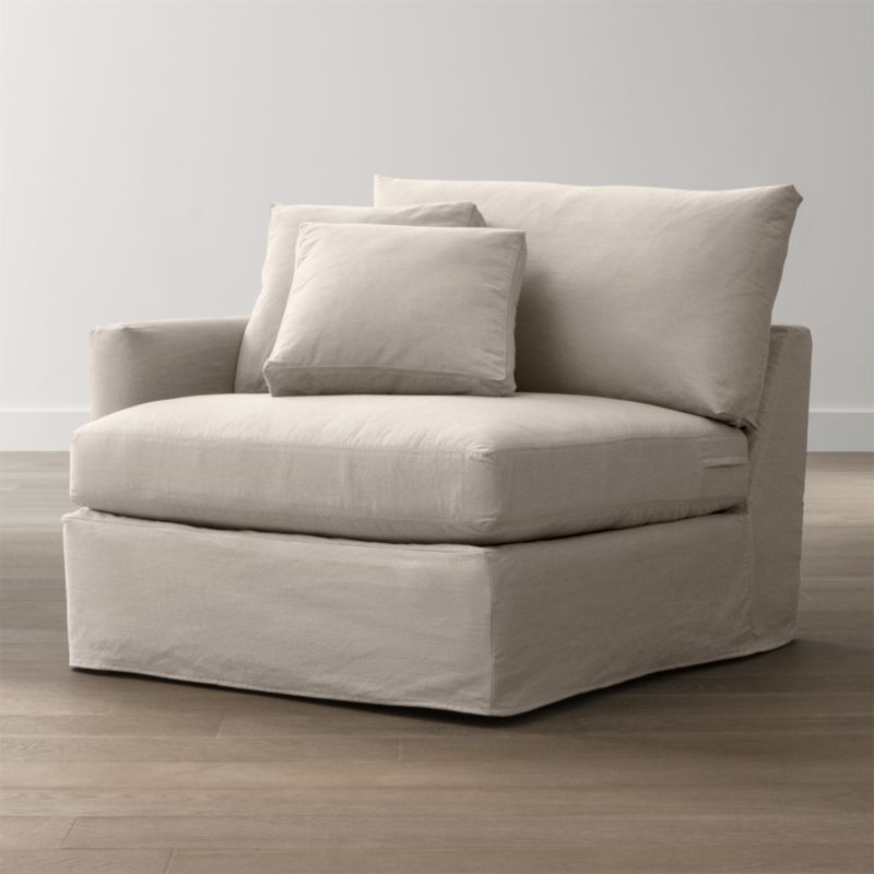 "Tailored to fit our Lounge Left Arm Chair, smart denim slipcover is tailored with a kickpleat skirt and jumbo double topstitch outlining its high slim arm and plump, deep cushions.<br /><br />Additional <a href=""http://crateandbarrel.custhelp.com/cgi-bin/crateandbarrel.cfg/php/enduser/crate_answer.php?popup=-1&p_faqid=125&p_sid=DMUxFvPi"">slipcovers</a> available below and through stores featuring our Furniture Collection.<br /><br />After you place your order, we will send a fabric swatch via next day air for your final approval. We will contact you to verify both your receipt and approval of the fabric swatch before finalizing your order.<br /><br /><NEWTAG/><ul><li>100% cotton</li><li>Machine washable</li><li>Jumbo contrast saddle stitch detail</li></ul><br />"