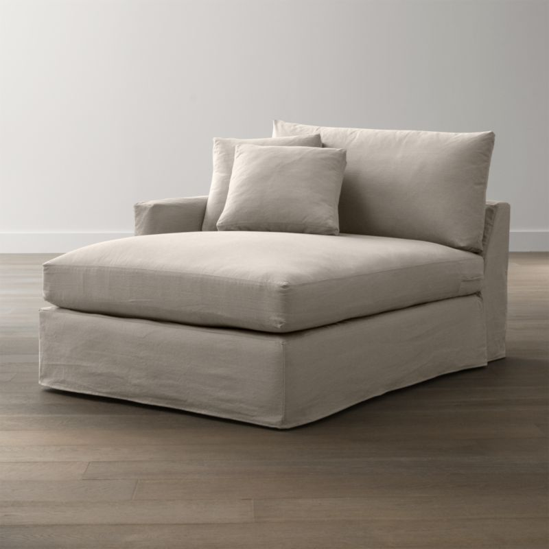 """Tailored to fit our Lounge Slipcovered Left Arm Chaise, smart denim slipcover is tailored with a kickpleat skirt and jumbo double topstitch outlining its high slim arm and plump, deep cushions.<br /><br />Additional <a href=""""http://crateandbarrel.custhelp.com/cgi-bin/crateandbarrel.cfg/php/enduser/crate_answer.php?popup=-1&p_faqid=125&p_sid=DMUxFvPi"""">slipcovers</a> available below and through stores featuring our Furniture Collection.<br /><br />After you place your order, we will send a fabric swatch via next day air for your final approval. We will contact you to verify both your receipt and approval of the fabric swatch before finalizing your order.<br /><br /><NEWTAG/><ul><li>100% cotton</li><li>Machine washable</li><li>Jumbo contrast saddle stitch detail</li><li>Made in North Carolina, USA of domestic and imported materials</li></ul><br />"""