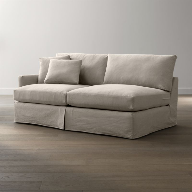 "Tailored to fit our Lounge Slipcovered Left Arm Sofa, smart denim slipcover is tailored with a kickpleat skirt and jumbo double topstitch outlining its high slim arm and plump, deep cushions.<br /><br />Additional <a href=""http://crateandbarrel.custhelp.com/cgi-bin/crateandbarrel.cfg/php/enduser/crate_answer.php?popup=-1&p_faqid=125&p_sid=DMUxFvPi"">slipcovers</a> available below and through stores featuring our Furniture Collection.<br /><br />After you place your order, we will send a fabric swatch via next day air for your final approval. We will contact you to verify both your receipt and approval of the fabric swatch before finalizing your order.<br /><br /><NEWTAG/><ul><li>100% cotton</li><li>Machine washable</li><li>Jumbo contrast saddle stitch detail</li><li>Made in North Carolina, USA of domestic and imported materials</li></ul><br />"