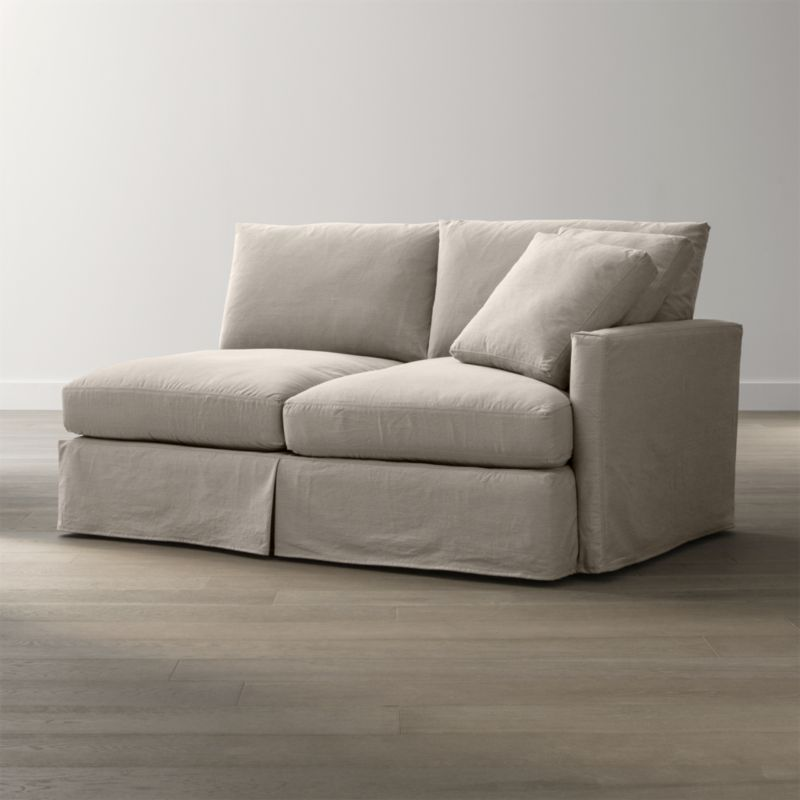 "Tailored to fit our Lounge Slipcovered Right Arm Apartment Sofa, smart denim slipcover is tailored with a kickpleat skirt and jumbo double topstitch outlining its high slim arm and plump, deep cushions.<br /><br />Additional <a href=""http://crateandbarrel.custhelp.com/cgi-bin/crateandbarrel.cfg/php/enduser/crate_answer.php?popup=-1&p_faqid=125&p_sid=DMUxFvPi"">slipcovers</a> available below and through stores featuring our Furniture Collection.<br /><br />After you place your order, we will send a fabric swatch via next day air for your final approval. We will contact you to verify both your receipt and approval of the fabric swatch before finalizing your order.<br /><br /><NEWTAG/><ul><li>100% cotton</li><li>Machine washable</li><li>Jumbo contrast saddle stitch detail</li><li>Made in North Carolina, USA of domestic and imported materials</li></ul><br />"