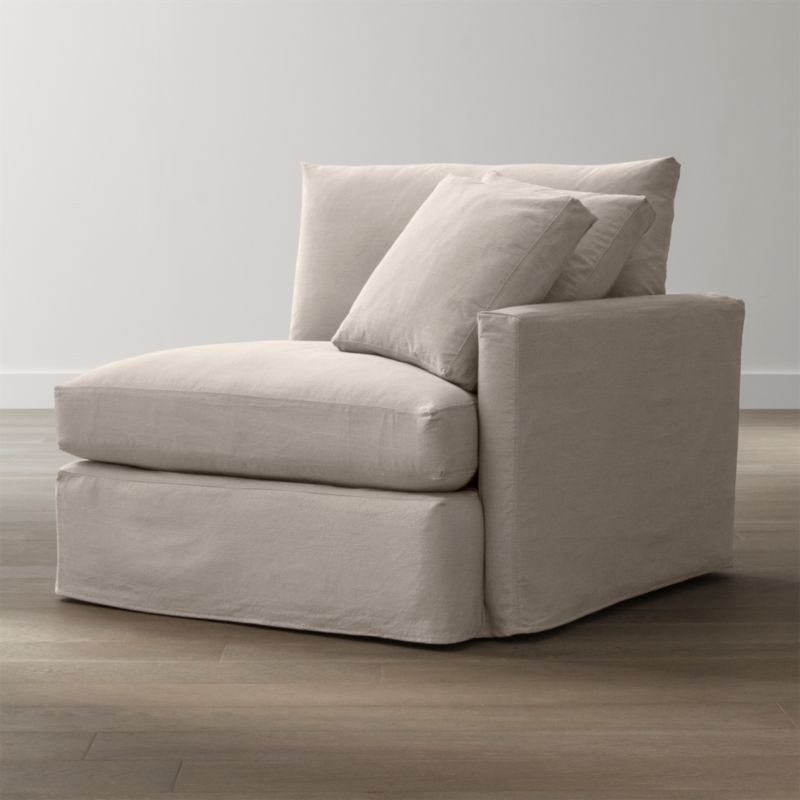 "Tailored to fit our Lounge Right Arm Chair, smart denim slipcover is tailored with a kickpleat skirt and jumbo double topstitch outlining its high slim arm and plump, deep cushions.<br /><br />Additional <a href=""http://crateandbarrel.custhelp.com/cgi-bin/crateandbarrel.cfg/php/enduser/crate_answer.php?popup=-1&p_faqid=125&p_sid=DMUxFvPi"">slipcovers</a> available below and through stores featuring our Furniture Collection.<br /><br />After you place your order, we will send a fabric swatch via next day air for your final approval. We will contact you to verify both your receipt and approval of the fabric swatch before finalizing your order.<br /><br /><NEWTAG/><ul><li>100% cotton</li><li>Machine washable</li><li>Jumbo contrast saddle stitch detail</li><li>Made in North Carolina, USA of domestic and imported materials</li></ul><br />"