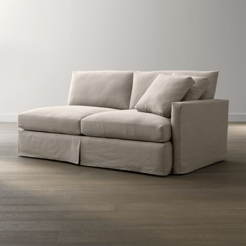 "Tailored to fit our Lounge Slipcovered Right Arm Sofa, smart denim slipcover is tailored with a kickpleat skirt and jumbo double topstitch outlining its high slim arm and plump, deep cushions.<br /><br />Additional <a href=""http://crateandbarrel.custhelp.com/cgi-bin/crateandbarrel.cfg/php/enduser/crate_answer.php?popup=-1&p_faqid=125&p_sid=DMUxFvPi"">slipcovers</a> available below and through stores featuring our Furniture Collection.<br /><br />After you place your order, we will send a fabric swatch via next day air for your final approval. We will contact you to verify both your receipt and approval of the fabric swatch before finalizing your order.<br /><br /><NEWTAG/><ul><li>100% cotton</li><li>Machine washable</li><li>Jumbo contrast saddle stitch detail</li><li>Made in North Carolina, USA of domestic and imported materials</li></ul><br />"
