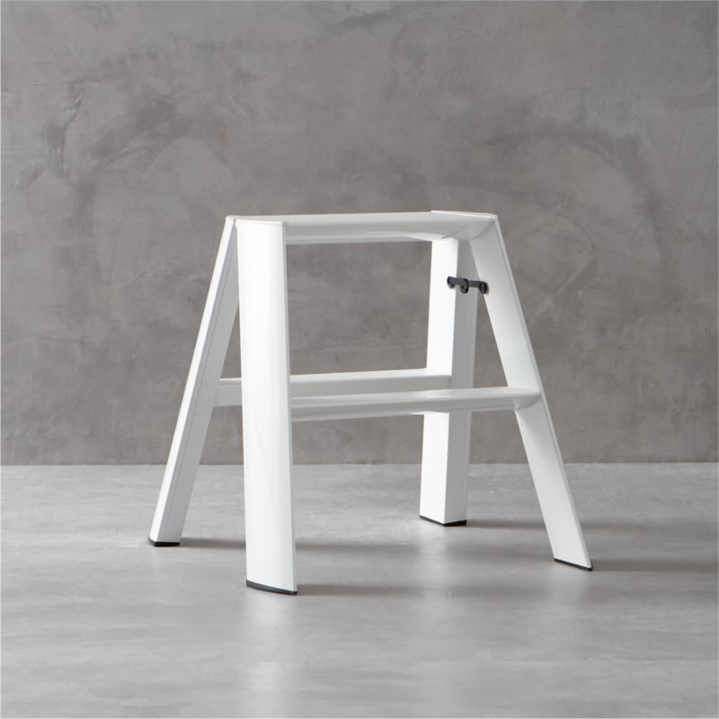 "The beauty is in the details when it comes to this meticulously designed step-stool. Expertly crafted and assembled by hand, and finished with a durable white powdercoated finish, smooth aluminum and steel form triangular tubes that meet in a slim, graceful profile. From the secure safety latch and non-skid feet to safety-minded steps with integrated grooves for tread, each and every element is thoughtfully considered—even the fastening screws are hidden. Sturdy yet surprisingly lightweight, this ladder weighs only 10 lbs. for easy portability and supports up to 300 lbs. in weight. Engineered to fold to a streamlined 8.25"" deep, it can also stand on its own without having to lean against the wall. Created by the experimental design lab Metaphys and Hasegawa Kogyo Co., the top manufacturer of ladders and scaffolding in Japan since 1956, this exceptional ladder has received many design accolades, including the RedDot Design, Good Design and JIDA Design Museum selection awards.<br /><br /><NEWTAG/><ul><li>Hand-assembled</li><li>Aluminum and steel with white powdercoat finish</li><li>Safety features include non-skid feet, grooved tread on steps and safety latch</li><li>Lightweight ladder weighs only 10 lbs. for easy portability</li><li>Supports up to 300 lbs.</li><li>Freestands or folds to 8.25 inches flat for storing</li><li>Made in China</li></ul>"