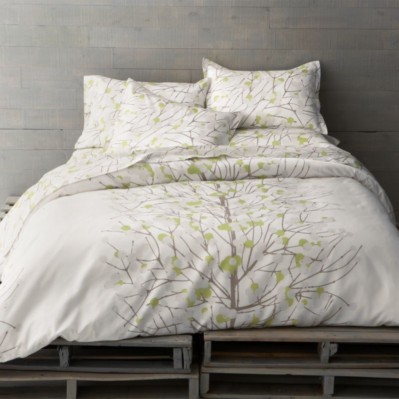 "Designed by Erja Hirvi in 2004, Lumimarja (""snowberries"") is a modern return to organic and natural design encapsulated elegantly in this Marimekko pattern. The snowberry, whose interior resembles crystalline snowflakes, is representative of the beauty that can be found throughout Finland's vast wilderness. Reversible duvet cover has a hidden button closure at the bottom and interior fabric ties to hold the insert in place. Duvet inserts also available.<br /><br /><NEWTAG/><ul><li>Pattern designed by Erja Hirvi; 2004</li><li>100% cotton sateen</li><li>300-thread-count</li><li>Machine wash cold</li><li>Made in Pakistan</li></ul>"