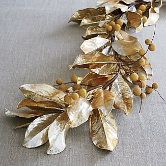 Our glamorous faux gold magnolia garland cascades gilded magnolia leaves studded with longan berries down the railing, across the mantle or across the holiday table.