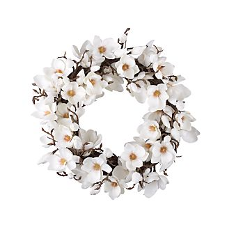 The delicate beauty of springtime magnolia blossoms lives on in gorgeous wreath for all seasons. Lifelike petals, twigs and buds shape a year-round message of welcome.