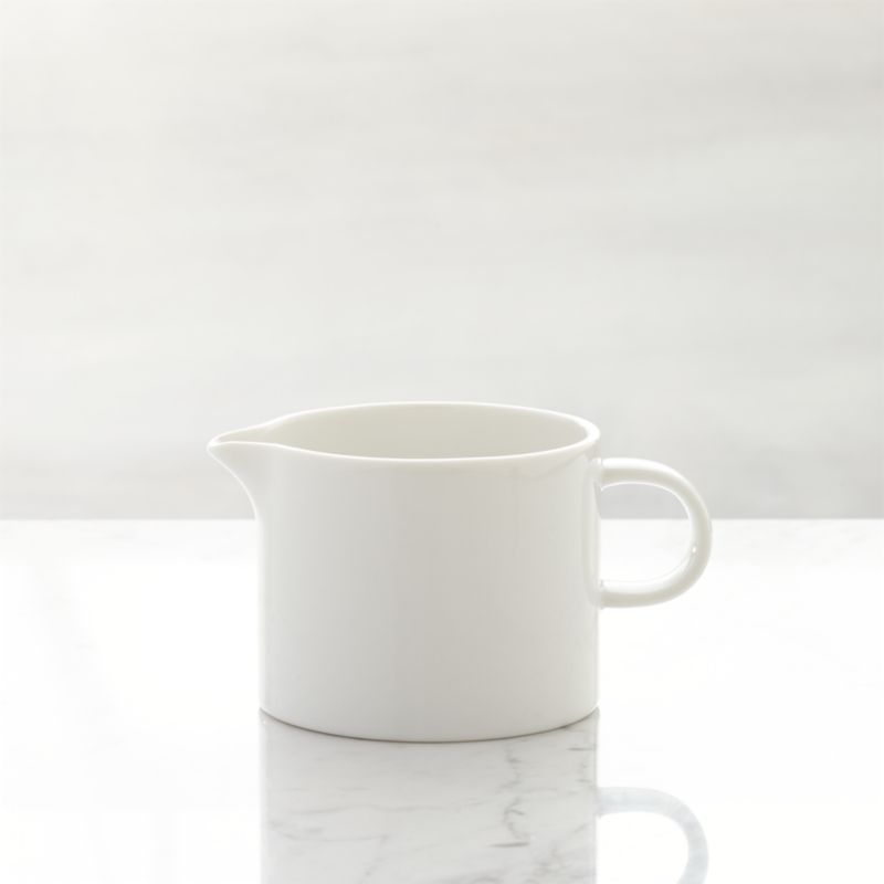 This streamlined, contemporary classic has long been a Crate and Barrel favorite for its fine quality, durablility and versatility. The simple, clean look of our Maison pure white porcelain creamer is sure to accent many memorable meals chez vous. Maison dinnerware also available.<br /><br /><NEWTAG/><ul><li>Porcelain</li><li>Dishwasher-, microwave- and warm oven-safe</li><li>Made in Japan</li></ul>