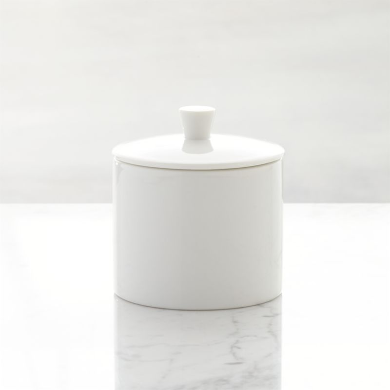 This streamlined, contemporary classic has long been a Crate and Barrel favorite for its fine quality, durability and versatility. The simple, clean look of our Maison pure white porcelain sugar bowl is sure to accent many memorable meals chez vous. Maison dinnerware also available.<br /><br /><NEWTAG/><ul><li>Porcelain</li><li>Dishwasher-, microwave- and warm oven-safe</li><li>Made in Japan</li></ul>