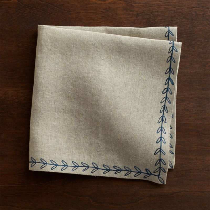 Deep blue embroidery traces a leafy trail on natural linen napkin. Mix and match with Marianna Dot napkins and coordinating placemats and runners.<br /><br /><NEWTAG/><ul><li>100% linen</li><li>Machine wash separately in cold water, dry flat</li><li>Do not dry clean, iron or bleach</li><li>Made in India</li></ul>