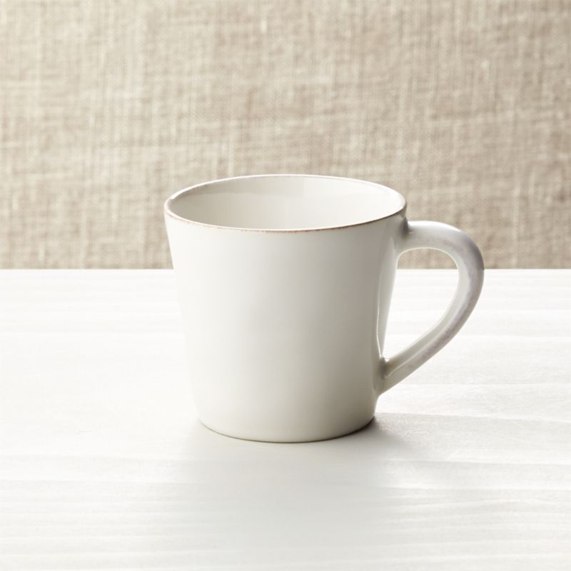 Artisanal ceramic shapes are glazed a soft white with subtle hand-antiquing on the freeform rims.<br /><br /><NEWTAG/><ul><li>Stoneware</li><li>Dishwasher-, microwave- and oven-safe to 300 degrees</li><li>Made in Portugal</li></ul>
