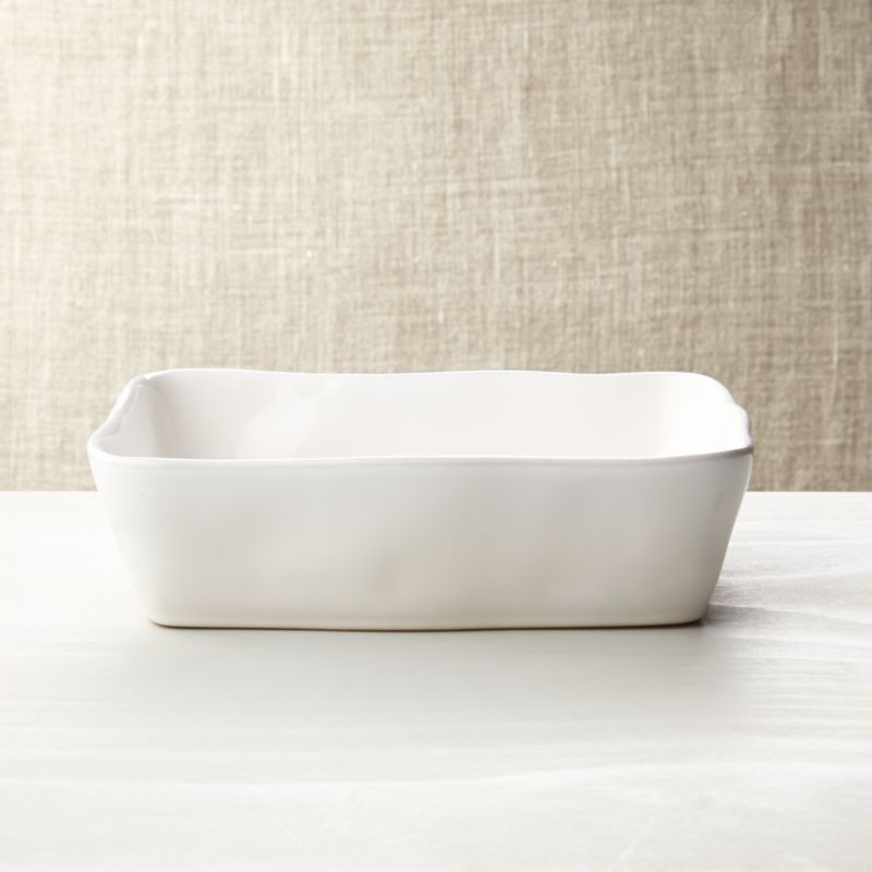 Artisanal ceramic baker is glazed a soft white with subtle hand-antiquing on the freeform rim. Marin White Dinnerware also available.<br /><br /><NEWTAG/><ul><li>Stoneware</li><li>Dishwasher-, microwave- and oven-safe to 450 degrees</li><li>Made in Portugal</li></ul>