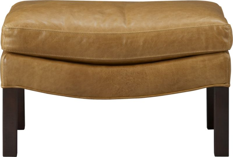 Sleek ottoman takes a curve in top-grain, full-aniline caramel leather, offering a leg up on luxurious relaxing. Subtly curved base props a plush cushion, accented with topstitched self-welting and distressed-finish legs.<br /><br />After you place your order, we will send a leather swatch via next day air for your final approval. We will contact you to verify both your receipt and approval of the leather swatch before finalizing your order.<br /><br /><NEWTAG/><ul><li>Solid maple with plywood</li><li>Top-grain, full-aniline leather</li><li>Synthetic webbing</li><li>Cushion is soy-based poly foamcore with fiber wrapped in feather-down blend</li><li>Walnut leg with distressed finish</li><li>Topstitched self-welt</li><li>Made in North Carolina, USA of domestic and imported materials</li></ul>