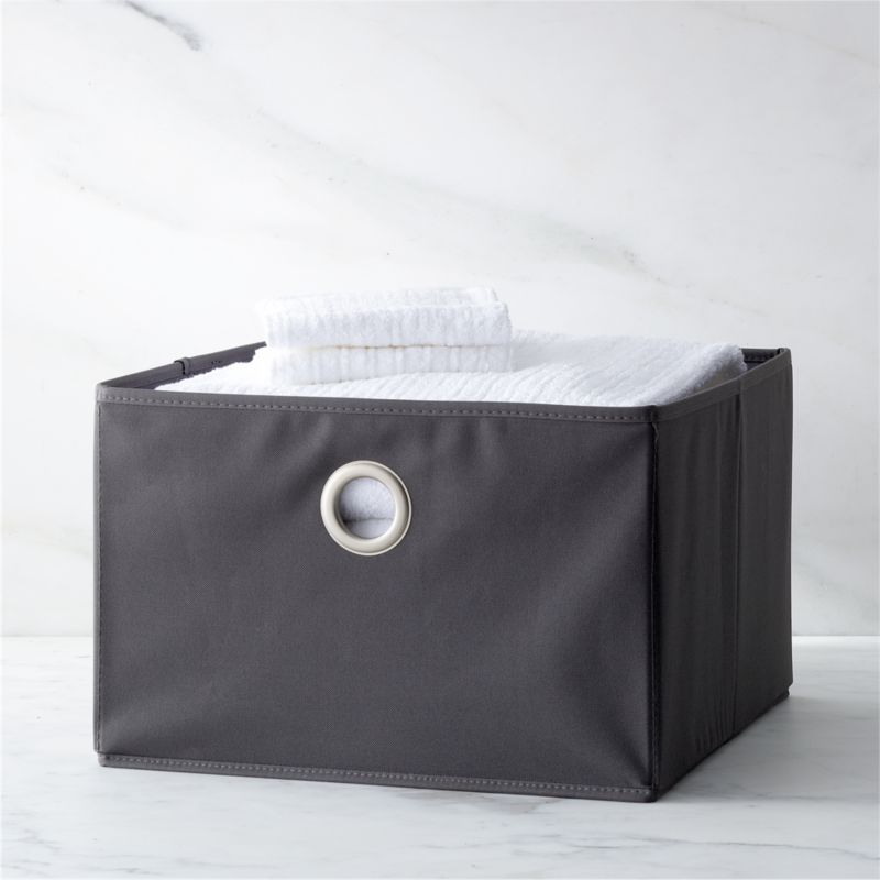 Neutral open storage bins with oversized grommet pulls provide all-purpose storage around the house, dorm or kid's room. Suitable for use on shelving. Totes fold flat for compact storage.<br /><br /><NEWTAG/><ul><li>Polyester and cardboard</li><li>Satin nickel-plated grommet</li><li>Clean with a damp cloth</li><li>Made in China</li></ul>