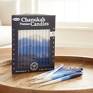 Gorgeous hand-dipped candles transition from deep blue to white, adding an elegant, ombre effect to the Hanukkah table. Due to their handcrafted nature, candles will vary slightly in design.