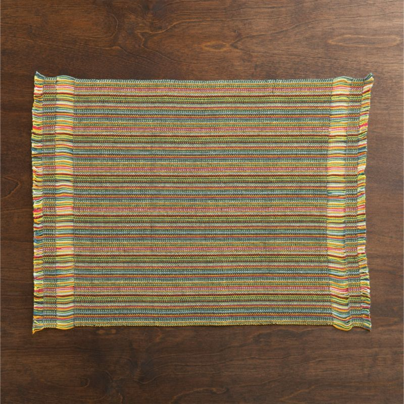 A brief pause in weaving weft yarns creates open, sheer stripes on either end of this festive placemat, woven of cotton in multicolor brights.<br /><br /><NEWTAG/><ul><li>100% cotton</li><li>Machine wash cold, line dry; warm iron as needed</li><li>Oversized to allow for shrinkage</li><li>Made in India</li></ul>