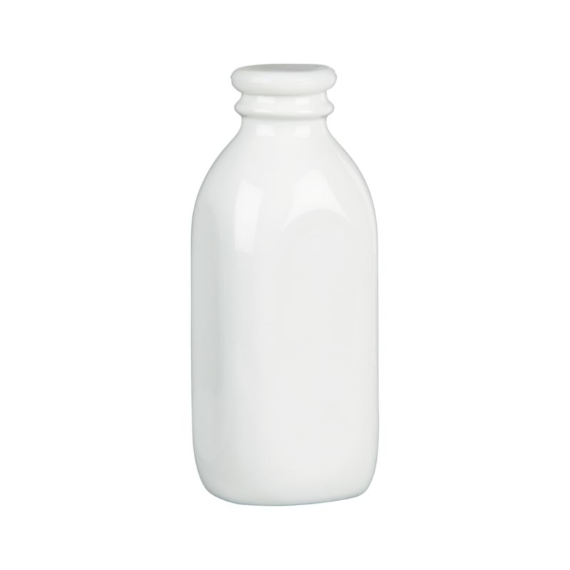 "Nostalgic porcelain bottle in a classic milk-bottle shape gives new life to the term ""milk glass."" Store-and-serve bottle is fitted with a silicone lid.<br /><br /><NEWTAG/><ul><li>Porcelain</li><li>BPA free silicone lids</li><li>Bottle is dishwasher-safe</li><li>Made in China</li></ul>"