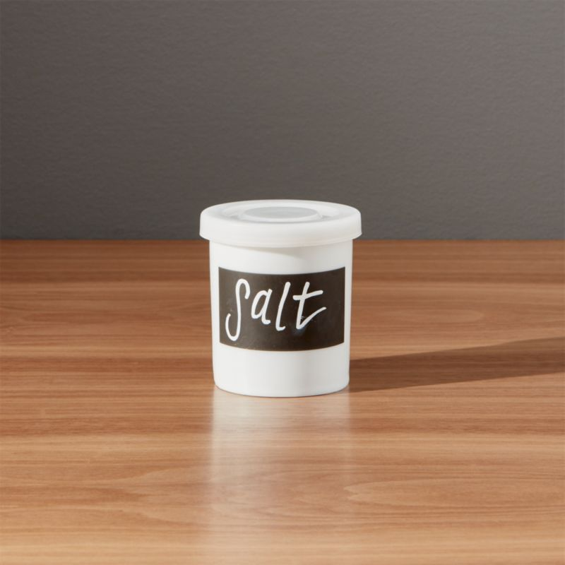 "Mini white porcelain canister features clean lines, snap-tight plastic lid and a ""chalkboard"" strip to label the contents.<br /><br /><NEWTAG/><ul><li>Porcelain</li><li>Plastic lid</li><li>Erasable chalkboard strip</li><li>Hand wash</li><li>Made in China</li></ul>"
