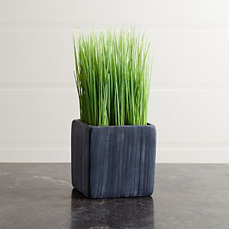 Row up these petite pots of faux grass for a modern twist on Easter décor or as an all-year interior accent. Square cement pot adds a rustic feel to its contemporary shape.