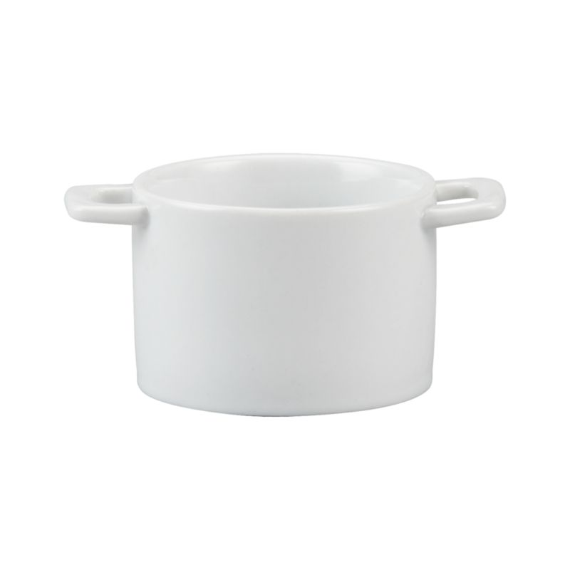 Deep round dish in bright white porcelain with convenient handles serves restaurant-style individual portions of everything from casseroles to cobblers.<br /><br /><NEWTAG/><ul><li>High-fired porcelain</li><li>Dishwasher-, microwave-, freezer- and oven-safe to 500 degrees</li><li>Made in China</li></ul>