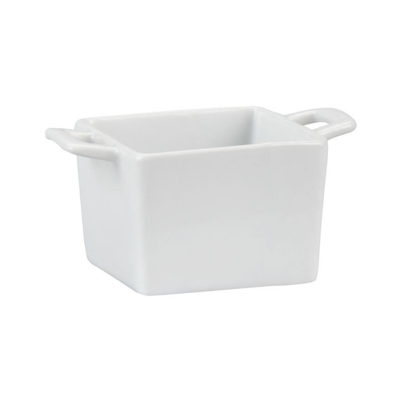 Deep square dish in bright white porcelain with convenient handles serves restaurant-style individual portions of everything from casseroles to cobblers.<br /><br /><NEWTAG/><ul><li>High-fired porcelain</li><li>Dishwasher-, microwave-, freezer- and oven-safe to 500 degrees</li><li>Made in China</li></ul>