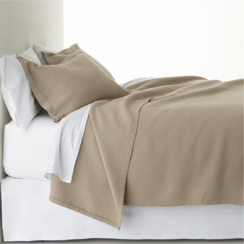 Delicious mocha bedding layers the bed in warm color, the perfect accompaniment to a range of solids and prints. Ultra-soft fabric is jacquard-loomed cotton stitched as a modern, textured matelassé.<br /><br /><NEWTAG/><ul><li>100% cotton</li><li>256-thread-count</li><li>Reversible</li><li>Machine wash cold, tumble dry low</li><li>Made in Portugal</li></ul>