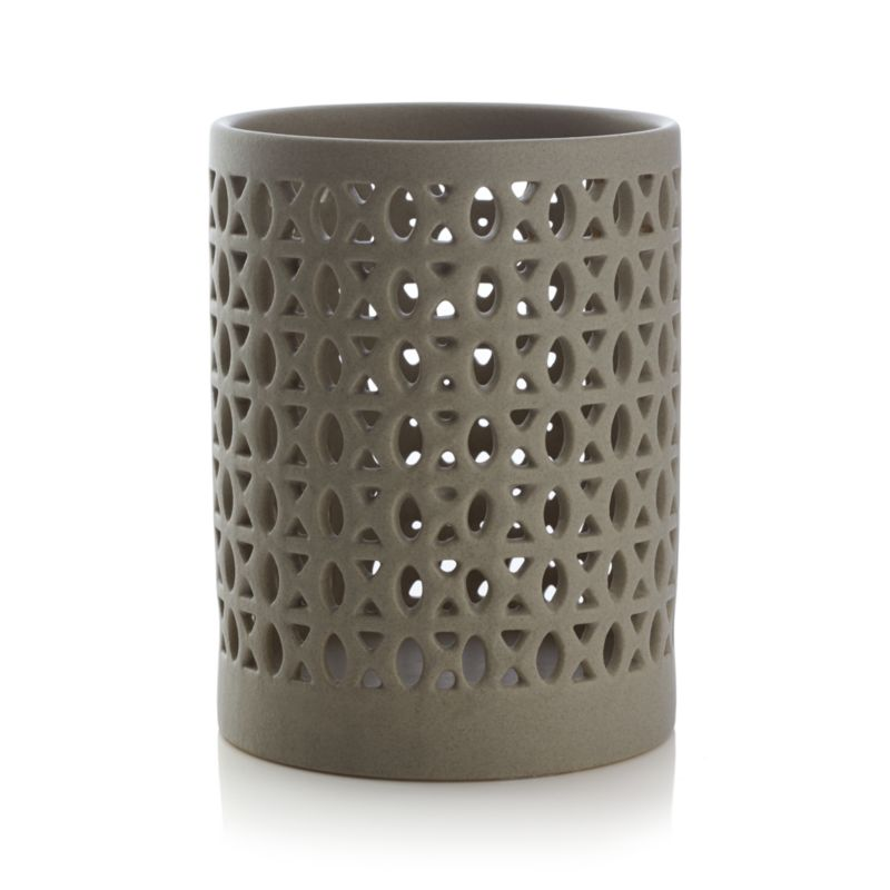 """Evocative Moroccan-inspired stoneware wraps a pillar candle in an intricate web, flickering warm, romantic lighting with a hint of exotic. Pairs with matching Molly votive candleholder.<br /><br /><NEWTAG/><ul><li>Stoneware</li><li>Accommodates up to 3""""-dia. pillar candle, sold separately</li><li>Dust with soft dry cloth</li><li>Made in China</li></ul>"""
